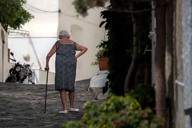 senior walking with cane