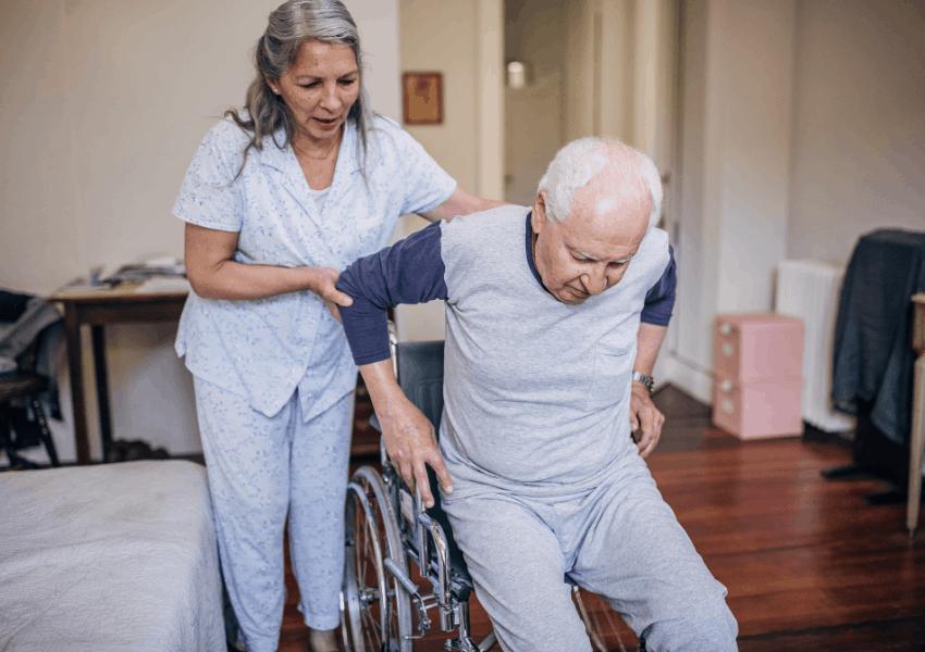 help senior into wheelchair