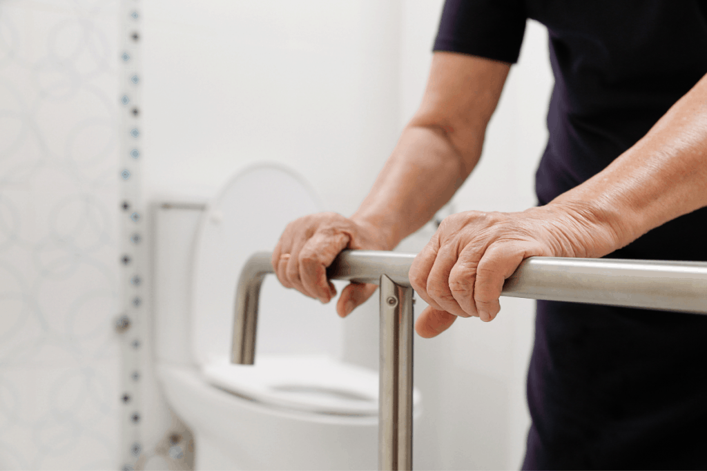helping-elderly-up-from-toilet